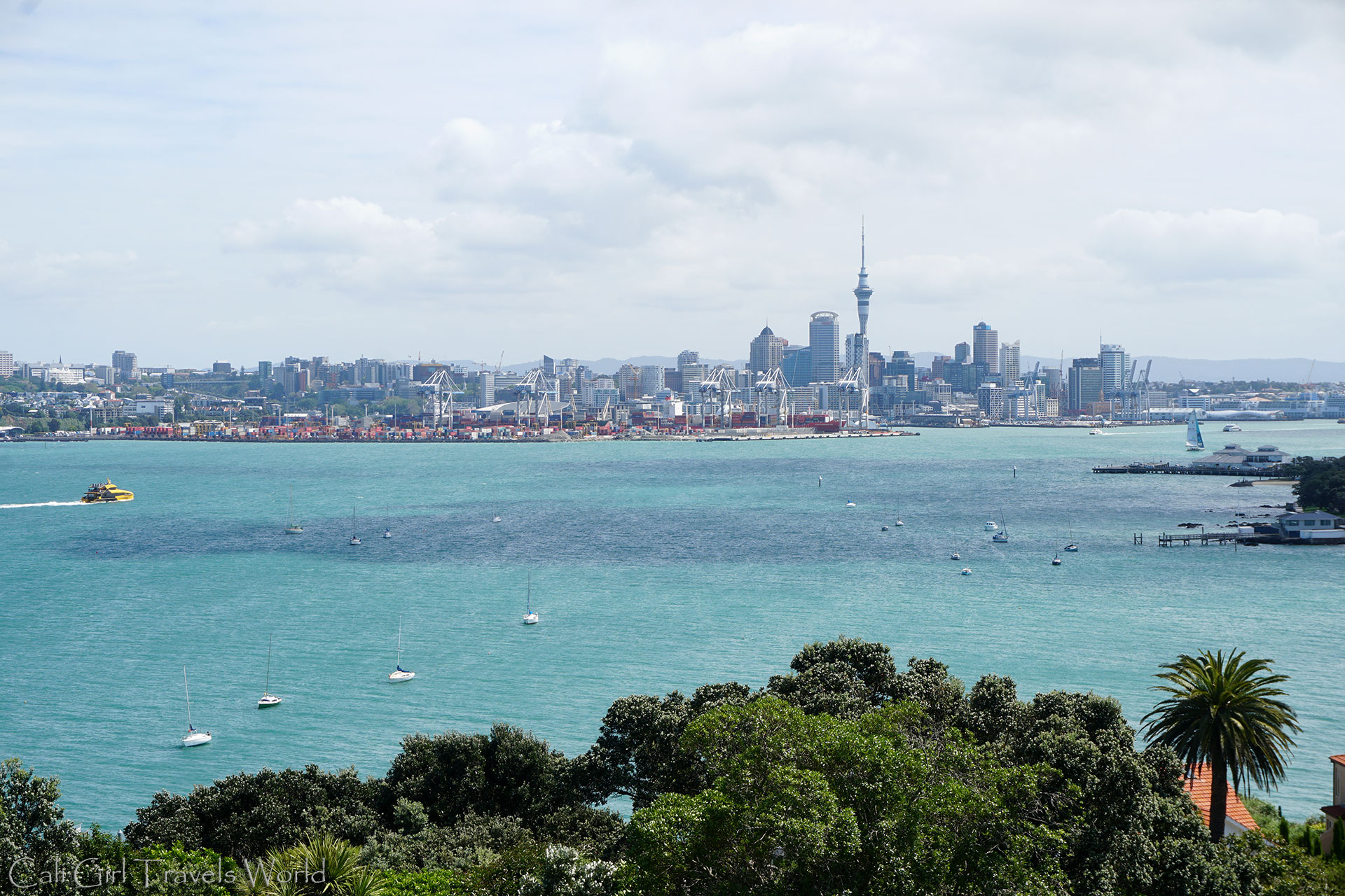 The view of the Auckland skyline and the ocean with sailboats, from Mount Victoria in Devonport in New Zealand.
