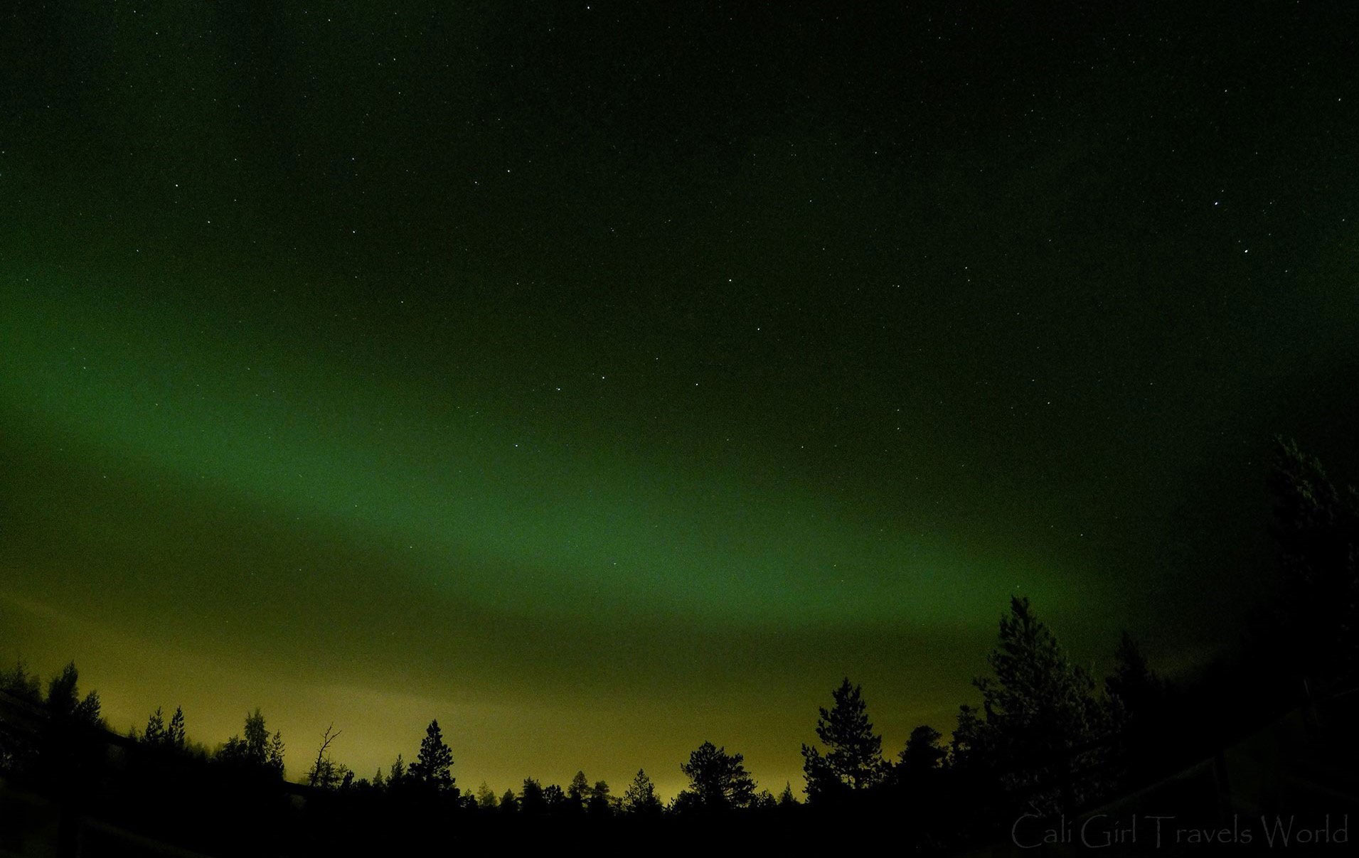 GoPro photo of the northern lights taken in the arctic circle, the aurora borealis is green and yellow.