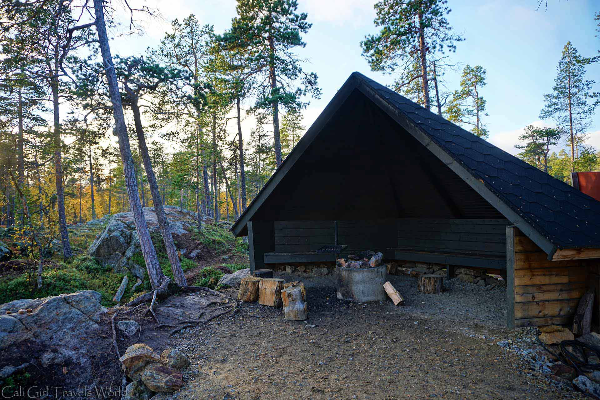 Wilderness hut shelter with a fire pit along a nature walk in Inari, Lapland.
