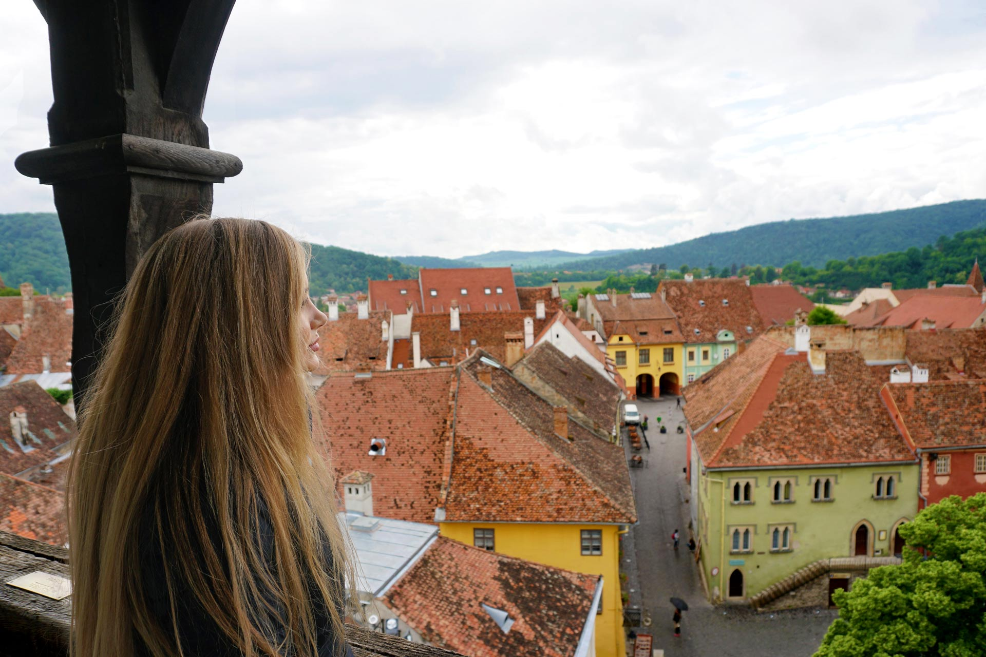 Hanging out the council tower for the best view in Sighisoara, Transylvania, Romania Cali Girl Travels World.