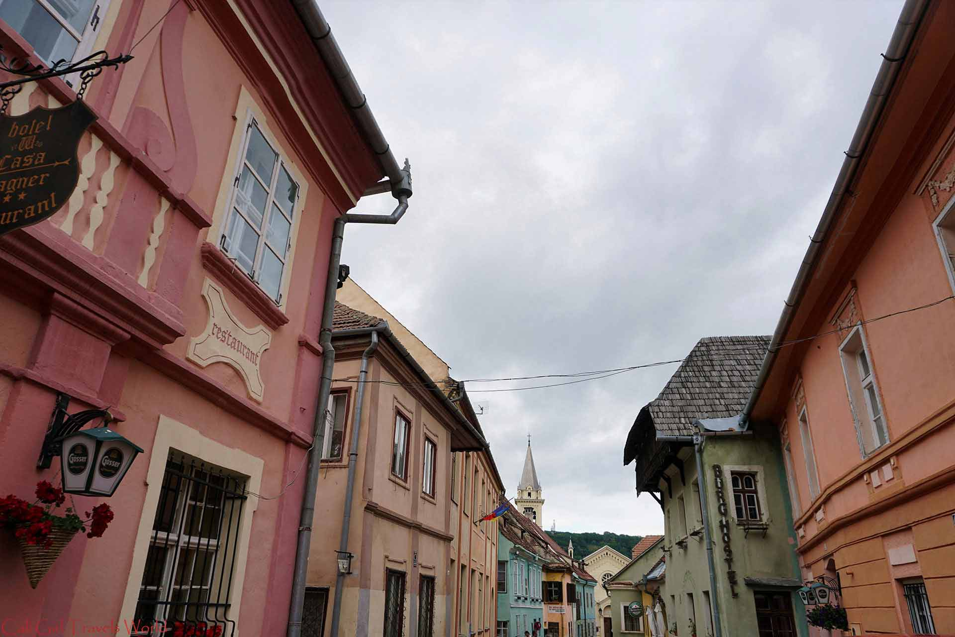Colorful homes of a medieval cobbled street in Sighisoara, Romania, Transylvania.