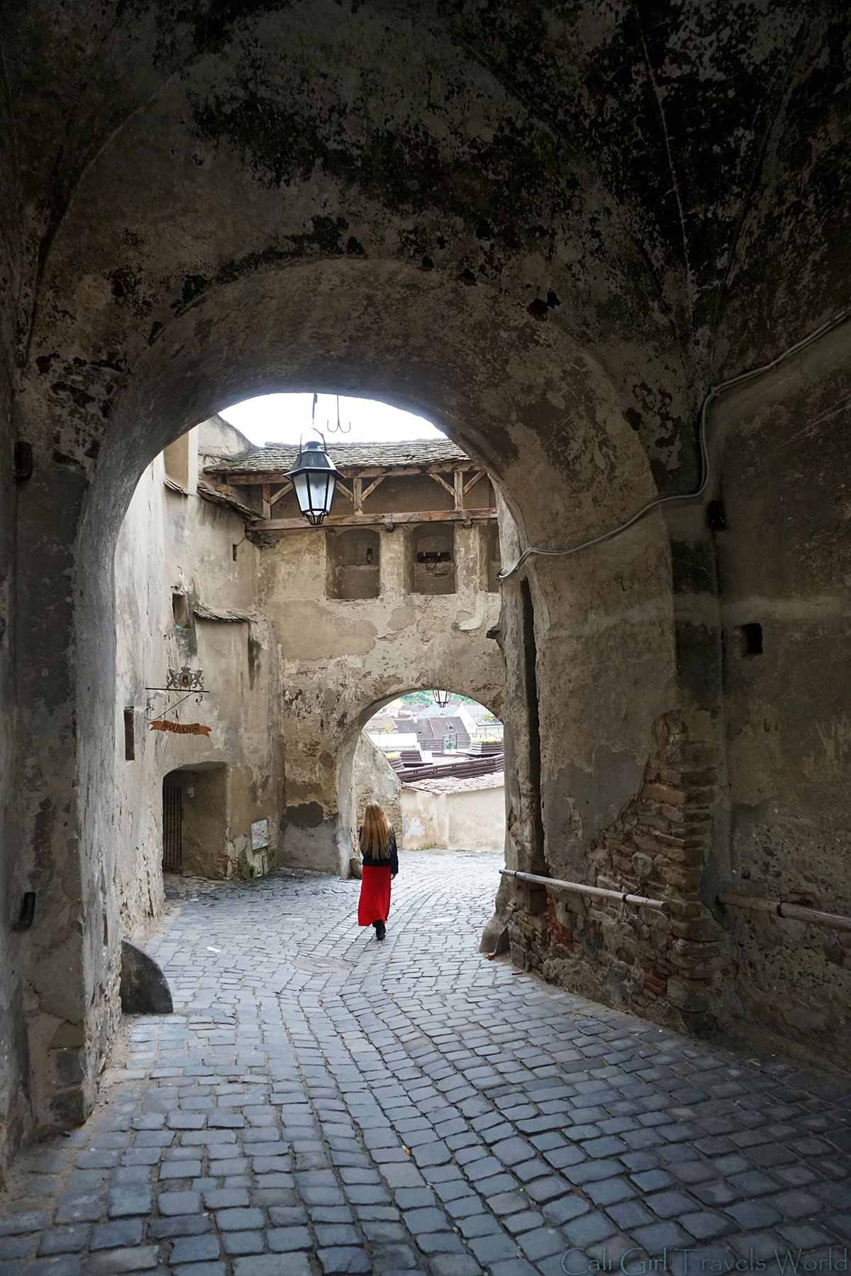Walking through the arches of Sighisoara, Romania