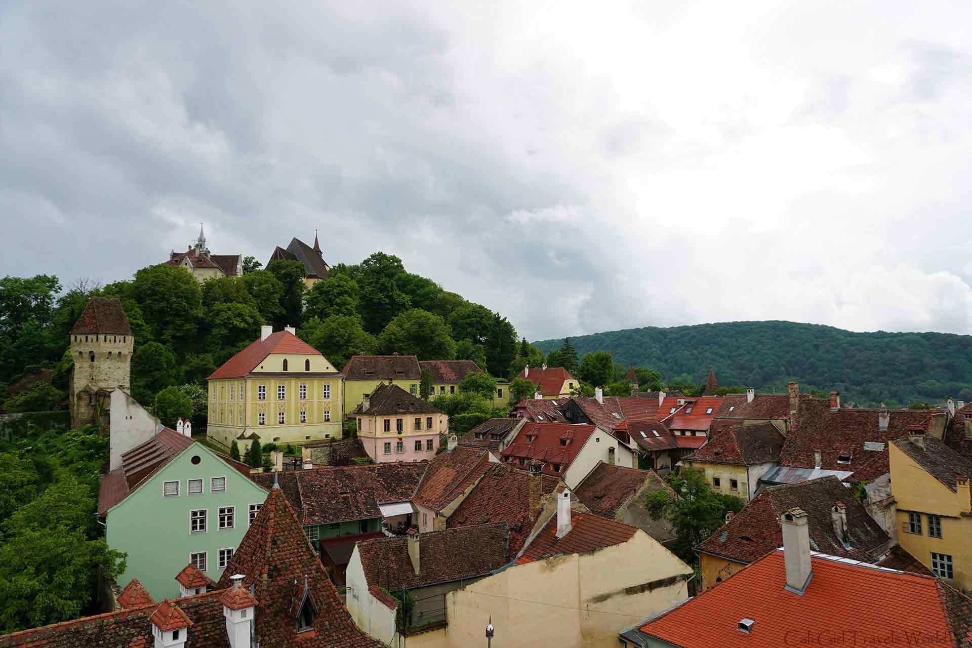 A view of buidings and a tower on a hilltop in Sighisoara, Romania.