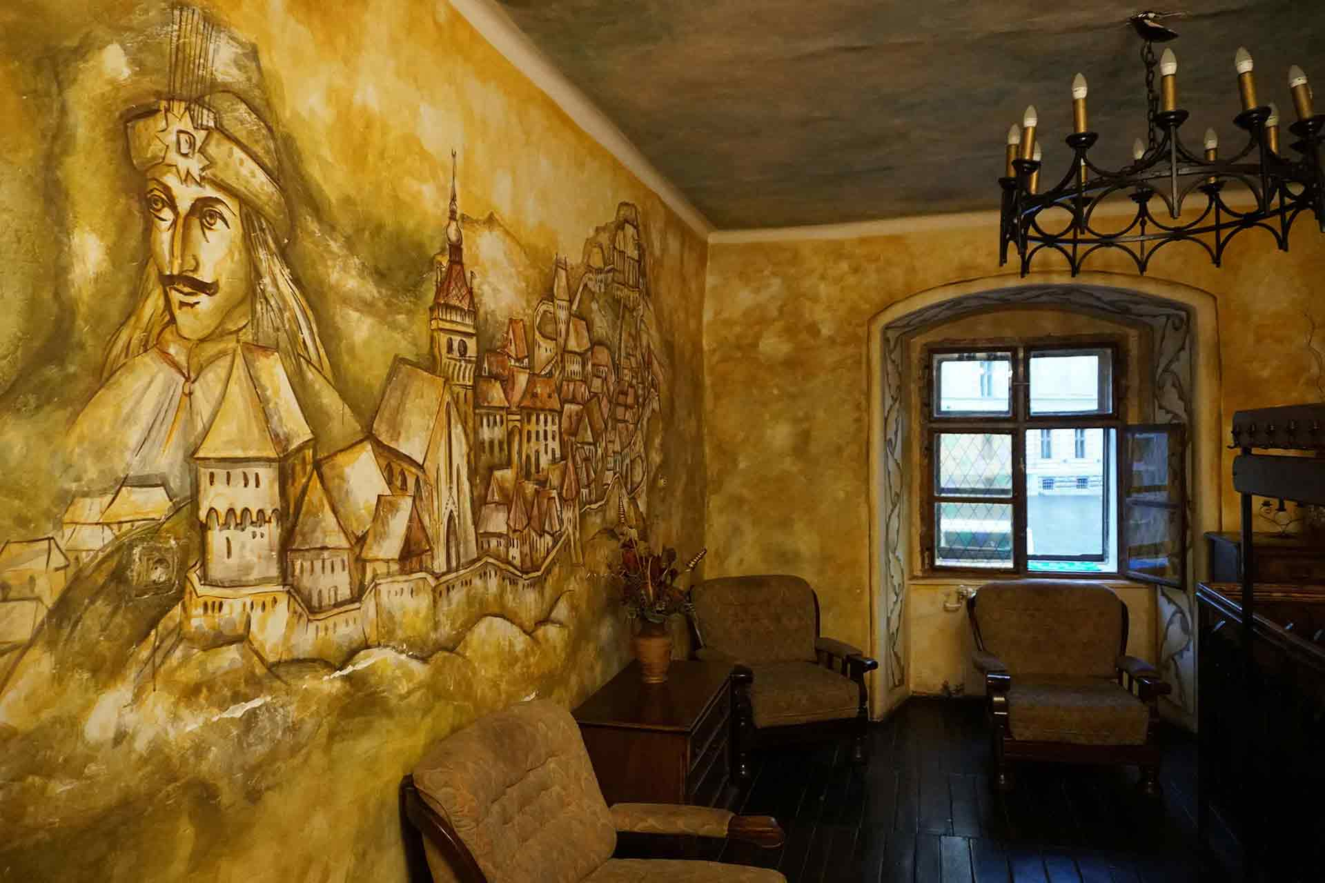 A photo of Dracula painting inside a resturant in Sighisoara where Vlad iii, the impaler was born.