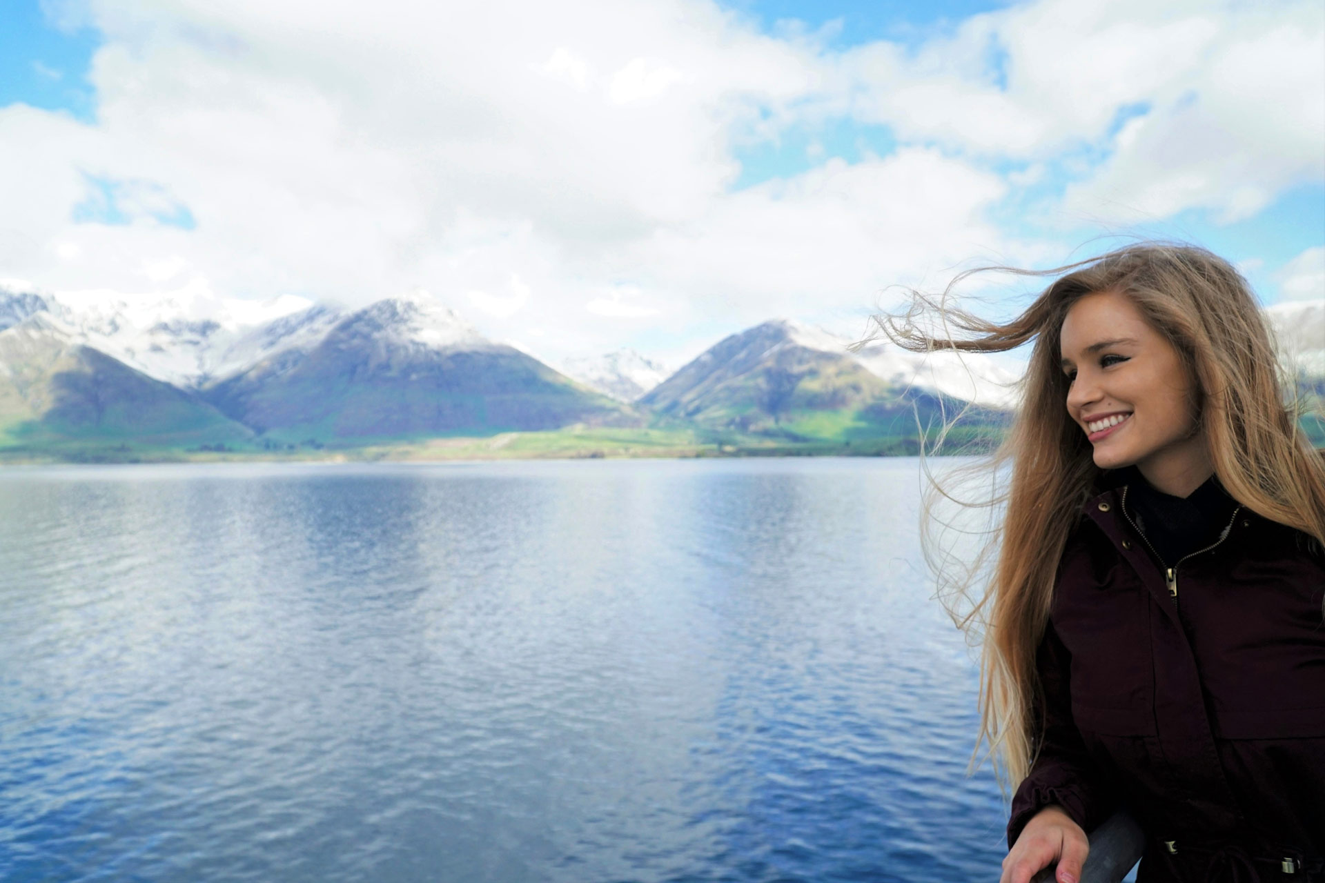 Travel Blogger Cali Girl Travels World on a ferry in Queenstown, NZ.
